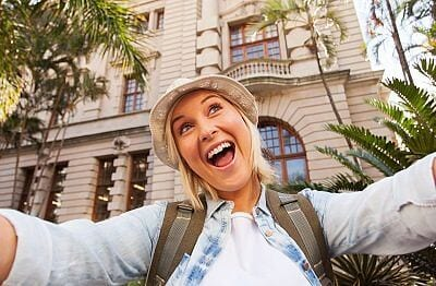 funny tourist taking selfie in front of historical building